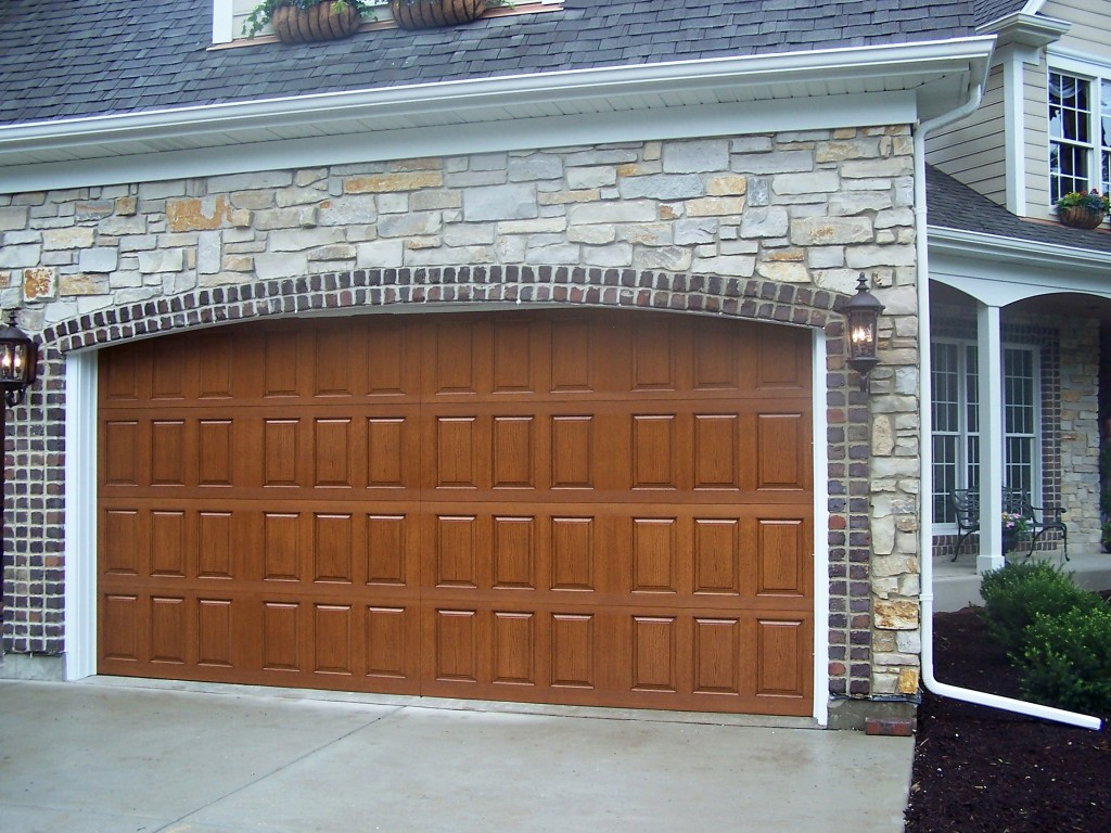 stone house wood wooden garage door luxury | Glicks | Glick Associates